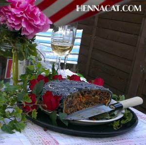 enna style gothic birthday cake by hennacat. On a table with flowers and a glass of wine
